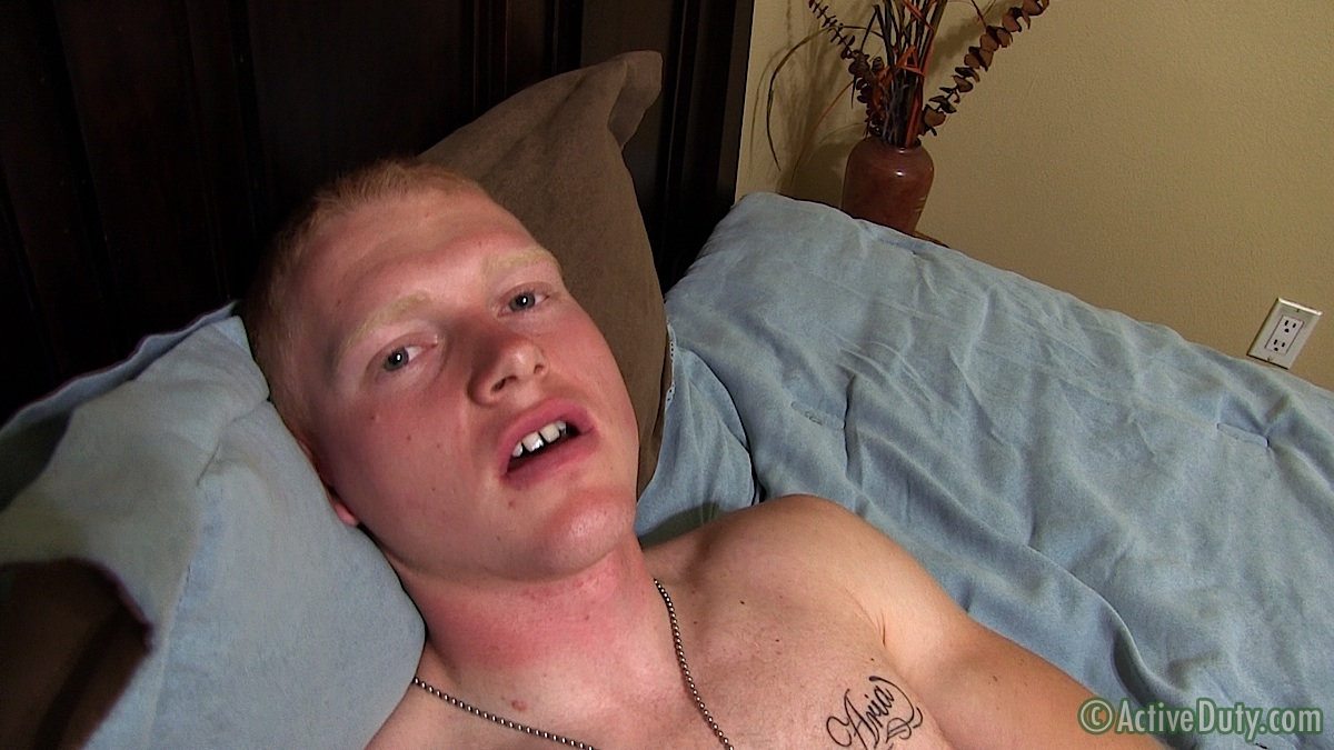 image Pale redhead jerks his curved cock while watching porn